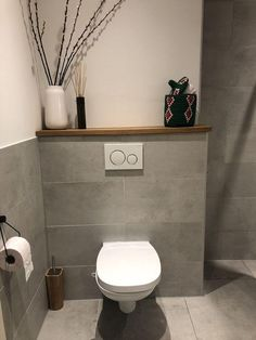 A shelf behind the toilet is practical and looks great! A shelf behind the toilet is practical and looks great! Read more styling tips for your toilet here. A shelf behind the toilet is practical Bad Inspiration, Bathroom Inspiration, Wc Decoration, Toilet Tiles, Toilet Bowl, Small Toilet Room, Natural Bathroom, Downstairs Toilet, Bathroom Toilets