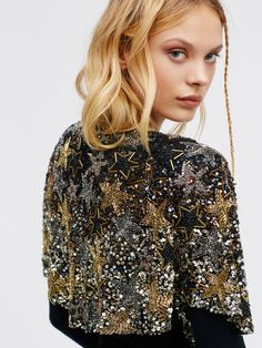 Cosmic Dancer Embellished Cape | Glam short sleeve cape with shimmering sequin embellishments allover in a shining star design. Front hook-and-eye-closure.