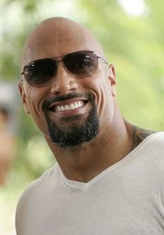 American actor Dwayne Johnson poses during a media...