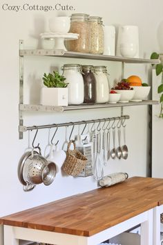 Going to get a long bar like one above and hang across my 2 kitchen windows and hang flower pots to grow my basil.  My kitchen windows get so much sun!