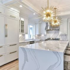 Marble waterfall countertops and statement pedant lights | Spectacular Kitchen | White and gold