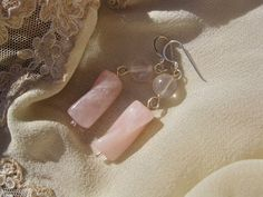 Rose Quartz and sterling silver earrings.  Rose Quartz is the LOVE gemstone. So these earrings make a beautiful token of love to send a special friend (eg: for Valentine's Day, an Engagement, or Anniversary)