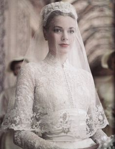 April American actress Grace Kelly marries Prince Rainier of Monaco. Photo: Princess Grace in her wedding dress, a gift from the MGM studio, designed by Academy Award Winning Costumer Helen Rose. Celebrity Wedding Dresses, Celebrity Weddings, Famous Wedding Dresses, Princesa Grace Kelly, Grace Kelly Wedding, Kate Middleton Wedding Dress, Helen Rose, The Bride, Bride Groom