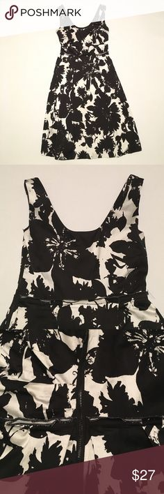 Ann Taylor dress black & white floral Ann Taylor dress with black and white splattered floral pattern. Semi-pleated skirt with round neckline on front and back. Side zipper with snap at the top. Size 0. Great condition. 61% rayon 36% cotton 3% spandex. Ann Taylor Dresses