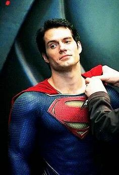 Henry Cavill on the set of Man of Steel getting his cape fixed between takes. So handsome!