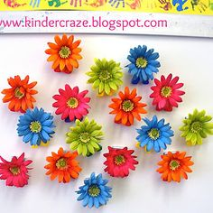 Glue fabric flowers to magnets or clips for your springtime bulletin board. | 36 Clever DIY Ways To Decorate Your Classroom