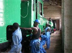 Garratt locomotive: Workers add the finishing touches to the steam engine at Sierra Leone's National Railway Museum, established in 2005
