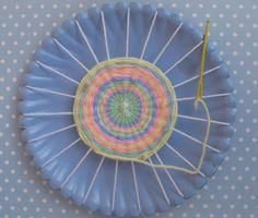 First steps in sewing: Paper Plate Weaving this colors are lovely