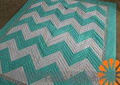 Really wish ang would make me a chevron quilt like this with orange and purple!! *hint hint*