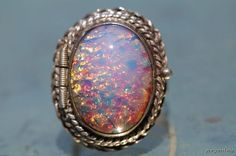 I always wanted a secret compartment ring...  Vintage Mexican Sterling Silver Foiled Art Glass Vinaigrette Poison Ring