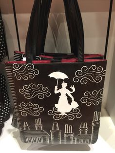 She'll pack-up the smiles for a day around town in this elegant Mary Poppins themed tote bag. This tote has faux leather and is covered with a whimsical print that is ''Practically Perfect In Every Wa
