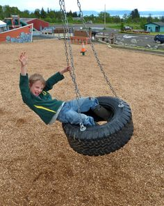 Pledge to visit a park on May 16 for Kids to Parks Day! Here, AK Kid spins on a tire at Homer's Karen Hornaday park. Erin Kirkland/AKontheGO