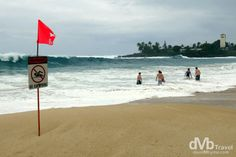 Only serious surfers allowed in the waters of Waimea Bay, North Shore, Oahu, Hawaii, USA. | dMb Travel - Travel with davidMbyrne.com