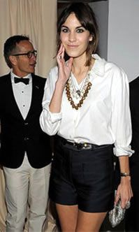 Alexa Chung dresses up her favourite White Shirt/Shorts ensemble for evening glam.
