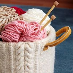 Turn an old sweater into a beautiful container for your yarn! | Clever crafts to make from old sweaters | Living the Country Life | http://www.livingthecountrylife.com/country-life/recreation/clever-crafts-make-old-sweaters/