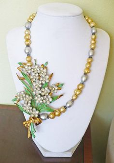 Vintage upcycled bouquet necklace featuring freshwater pearls and labradorite gemstones