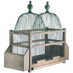Bring a touch of charm to your home with this eye-catching accent.Product: Birdcage d�corConstruction Material: Wood and metalColor: Brown and greenFeatures:  Charming designWill enhance any setting Dimensions: 26.5 H x 28.5 W x 11.5 D