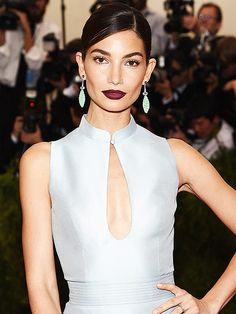 The 2015 Met Gala Beauty Awards | VAMPIEST LIP: LILY ALDRIDGE | In one of the night's biggest bold beauty moments, the Victoria's Secret Angel paired a deep, plum-colored lip to stand out against her plunging pale blue Caroline Herrera gown, slicked-back chignon and lime-green earrings – and we're totally for it.