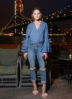 Olivia Palermi, denim on denim, distressed jeans, ruffled blouse. Sandals with fur.