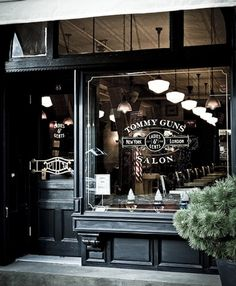 Store Front...tommy guns salon . brooklyn. Love the vintage look of the window and the black is very sexy