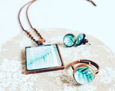 Browse unique items from MinouLaLaBoutique on Etsy, a global marketplace of handmade, vintage and creative goods.  #etsy #etsyseller #etsyuk #jewellery #floral #tropical #tropicalbreeze #floralphotography #productphotography #pendant #photojewellery #necklace #ring #earrings #handcrafted #handmade #creativebusiness