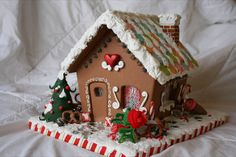 I make wooden and polymer clay gingerbread houses.