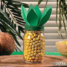 Create a tropical centerpiece your guests can grab candy out of! Easy to craft, this eye-catching candy jar centerpiece is great for your next backyard luau ...