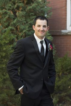 Classic black groom outfit idea - black suit with black neck tie + red rose boutonniere {Jessie Moore Photography}