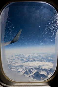 The Alps through an airplane window by Jouri Jalving, via Flickr