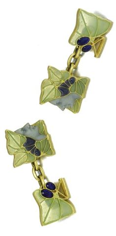 ROMANOV HEIRLOOMS: THE LOST INHERITANCE OF GRAND DUCHESS MARIA PAVLOVNA: Bacchus: A rare pair of gold and enamel cufflinks, Lalique, Paris, circa 1900, each painted en plein with the face of the wine god within plique-à-jour vine leaves and opaque enamel grapes.
