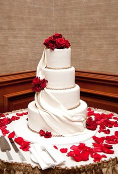 """To achieve a romantic cake design, you should always contrast the red roses with an elegant white cake.""  www.sheknows.com/love-and-sex/wedding-dress-of-the-day-gallery/wedding-cake-inspiration/romantic-red"
