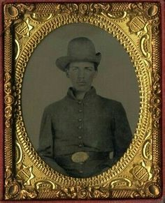 Ambrotype, a studio portrait of a Confederate soldier identified as Deforest Parker, c. 1861-65. Ninth plate, housed under decorative mat and preserver in pressed paper geometric pattern case. Size refers to image excluding case. Subject wears slouch hat, shell jacket and belt. Belt buckle has heavy gold tinting applied, obscuring the design. (Continued in comments.)