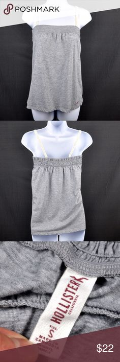 "Hollister Heather Grey Spaghetti Strap Tank The perfect attire for warm summer weather. Adorable Hollister Tank with lacy straps and flowy style. 60% cotton 40% polyester. Measured flat: bust: 13"", length: 24.5"". Smoke free pet friendly home. Hollister Tops Tank Tops"
