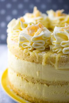 Lemon and almond sponge layered with the lightest lemon cheesecake mousse. Topped with lemon fool (whipped cream with lemon curd folded in) piped rosettes and crystallised pineapple chunks