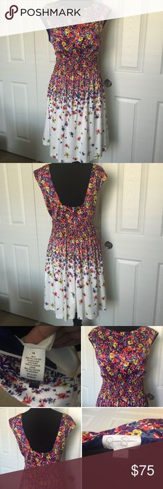 🎉 HP🎉 JESSICA SIMPSON Falling Flowers Dress Gorgeous Floral dress with high neck and open back. With Pockets! Skirt has a light tulle lining. Royal blue, with yellow, orange, grey & purple flowers. Never worn, excellent condition. NWOT, size 14. Smoke/pet free home. 🎉Host Pick 🎉 Everything Plus Size Party 🎉 01/24/2017🎉 Jessica Simpson Dresses