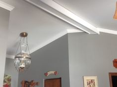 Faux beam added to separate foyer to living area. Added crown moulding to vaulted ceiling.
