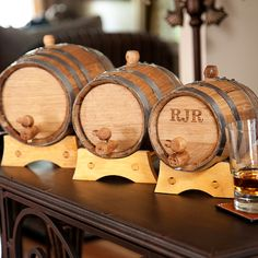 Age your own liquor in a mini oak barrel! Personalized Mini Whiskey Barrel with Steel Bands. #groomsmengifts