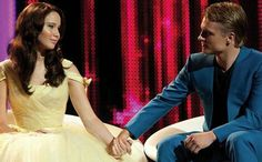 Jennifer Lawrence and Josh Hutcherson as Katniss Everdeen and Peeta Mellark