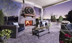 Ready to relax by the fire? An inviting outdoor space to enjoy with family and friends. A new home in the Edgewater community by Front Door Communities. Canton, GA.