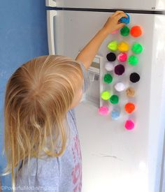 Make magnetic pom poms for patterning on the fridge. great idea for keeping toddlers and preschoolers busy in the kitchen.