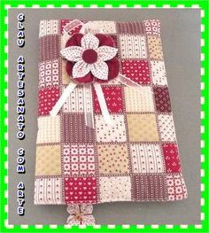 http://www.euquefaco.com.br/produto/capa-para-caderno-de-tecidos-7731