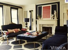 navy room - the carpet and center ottoman are lovely