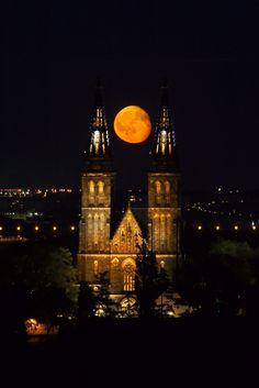 The moon rising between the spires of Vysehrad Church in Prague, Czech Republic keep-looking-up