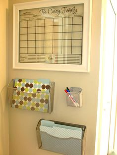 Have a framed calendar and folders for paperwork or mail to go through at your convenience.  Get it functional first; then worry about making it attractive