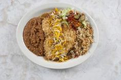 Chuy's take on the Southern favorite chicken fried chicken, Elvis Green Chile Fried Chicken is a tender chicken breast breaded with Lays® potato chips, deep fried and smothered in Green Chile Sauce and cheddar cheese.