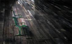 Photograph of an abandoned Bench with lamp light shining on it