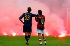 Materazzi and Rui Costa of the most iconic scenes of the Derby della Madonnina as Inter Milan Defender Marco Materazzi and AC Milan Midfielder Rui Costa look on whilst the San Siro pitch is. Football Is Life, World Football, Football Soccer, Football Shirts, Football Rivalries, Milan Football, Soccer Fans, Ac Milan, Football Pictures