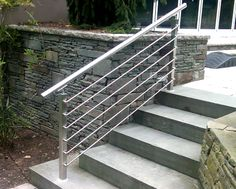 Stainless Steel Modular Crossbar Infill System at stair location.