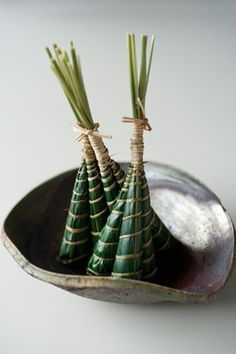 Japanese traditional sweets, Chimaki(ちまき、粽) - a cake wrapped in bamboo leaves.