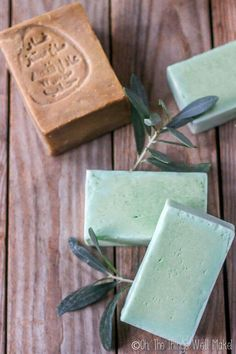 Golden Aleppo soap surrounded by green bars of homemade laurel soap.